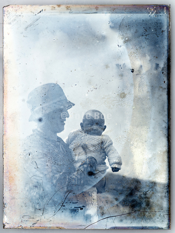 extreme deteriorating glass plate with mother and little toddler France ca 1920s
