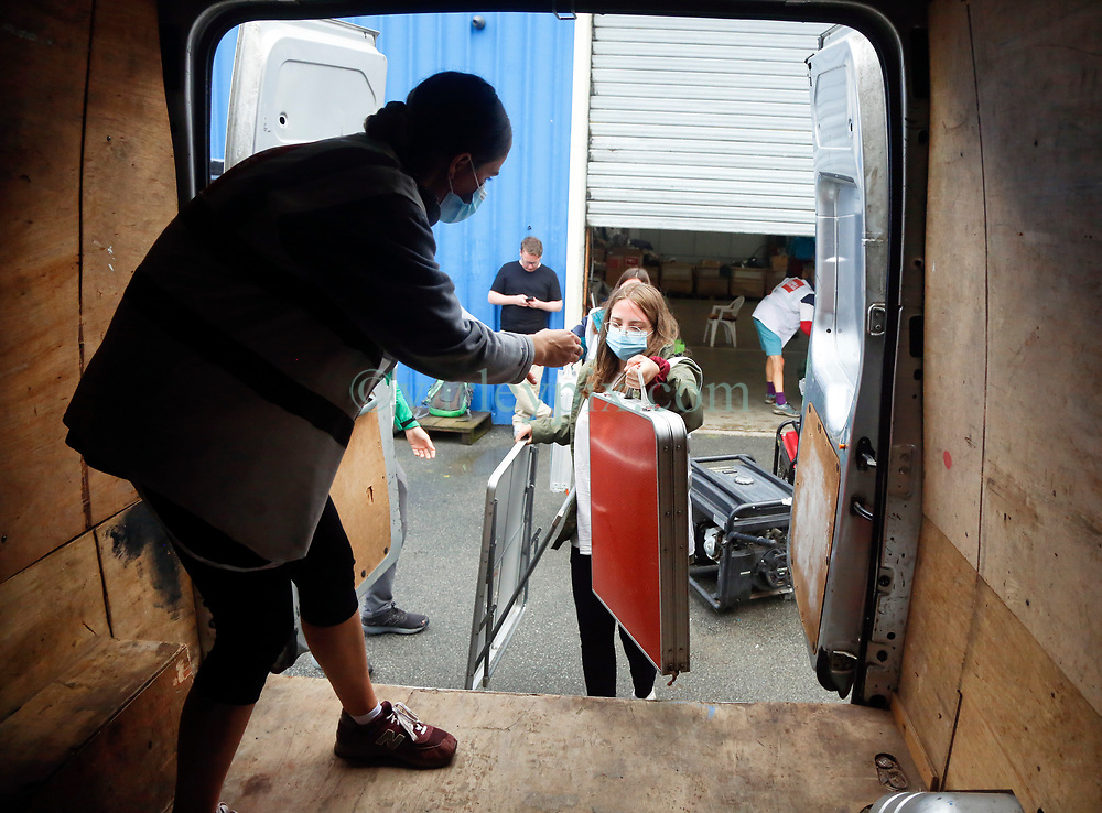 30 July 2021. Calais, France.<br /> Volunteers at British founded charity Care4Calais load a van as they prepare to head out offering assistance in the form of food, phone charging, tents, blankets, tarpaulins and other vitally needed services to migrant refugees in Calais. With police ramping up efforts to make Calais as hostile as possible, it has become increasingly difficult for charities to help migrants, many of whom have taken to living in swampy inhospitable terrain spread around the town. <br /> Photo©; Charlie Varley/varleypix.com