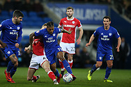 Kadeem Harris of Cardiff City © is tackled by Joseph Williams of Barnsley . EFL Skybet championship match, Cardiff city v Barnsley at the Cardiff city stadium in Cardiff, South Wales on Tuesday 6th March 2018.<br /> pic by Andrew Orchard, Andrew Orchard sports photography.