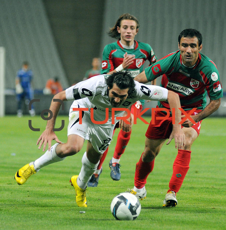 Karsiyakaspor's Fuat ERARSLAN (R), Taha YALCINER (B) and Altayspor's Sehmus OZER (F) during their Play Off First leg match at Ataturk olympic Stadium in Istanbul Turkey on Monday, 17 May 2010. Photo by TURKPIX
