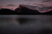 Views of the mountains across the Vermillion Lakes, just outside Banff Townsite, in Banff National Park, Alberta. This is Mount Rundle, taken with long exposure