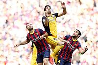 FC Barcelona's Javier Mascherano (l) and Cesc Fabregas (r) and Atletico de Madrid's Raul Garcia during La Liga match.May 17,2014. (ALTERPHOTOS/Acero)