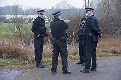 © Licensed to London News Pictures 10/03/2021. Ashford, UK. A police team in the grounds. Teams of police officers are at Great Chart Leisure in Ashford, Kent which is believed to be part of an ongoing investigation into the disappearance of Sarah Everard from London. Photo credit:Grant Falvey/LNP