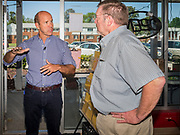 23 MAY 2019 - DES MOINES, IOWA: Congressman JOHN DELANEY (D-MD), left, talks to an Iowa public school teacher during a tour of the Iowa Food Cooperative in Des Moines. He toured the co-op to help understand how Iowa farmers are finding new markets. Delaney is running to be the Democratic nominee for the US Presidency in the 2020 election and has visited all 99 of Iowa's counties. Iowa traditionally hosts the the first election event of the presidential election cycle. The Iowa Caucuses will be on Feb. 3, 2020.                           PHOTO BY JACK KURTZ