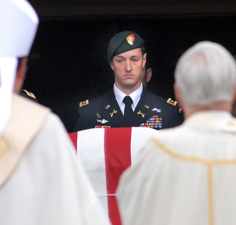 St. George Church, Guilford: One of the Special Forces pallbearers carried the casket of Capt. Andrew Pedersen-Keel, killed in Afghanistan, out of the church after his funeral. Mara Lavitt/New Haven Register<br /> <br /> 3/25/13