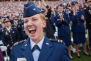 """13 MAY 2009 -- TEMPE, AZ: Ashley Hastings (CQ) a ROTC graduate who will be commissioned as a 2nd Lt in the US Air Force cheers for Alice Cooper while he sings his 1970's hit, """"School's Out.""""  President Barack Obama addressed the Arizona State University class of 2009 during the commencement program in Sun Devil Stadium in Tempe Wednesday evening.  PHOTO BY JACK KURTZ"""