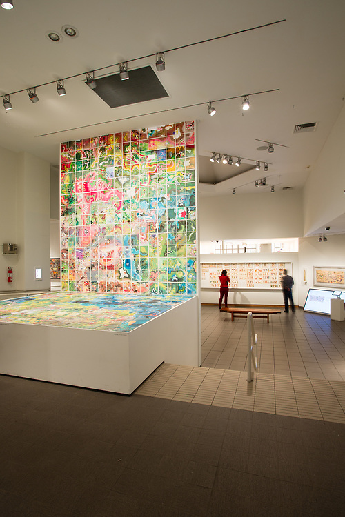 """The galleries of The American Folk Art Museum, with Jerry Gretzinger's """"Jerry's Map,"""" in mulitple panels and cards."""