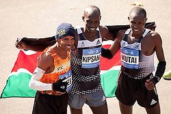 NYC Marathon, prior marathon champs in New York, Meb Keflezighi and Geoffrey Mutai join today's winner Wilson Kipsang in a flag-draped pose at the finish