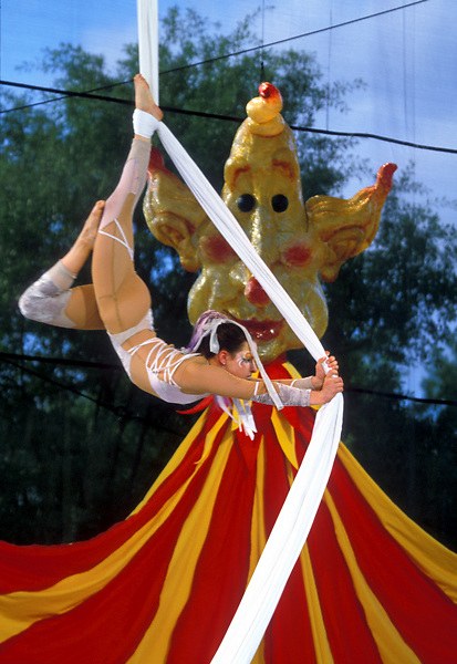 Stock photo of a woman putting on  an aerial acrobatic show at the International Festival in downtown Houston Texas