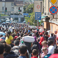 Illegal migrants started walking in the direction of Wien, Austria on foot from the transit zone at the main railway station Keleti in Budapest, Hungary on September 04, 2015. ATTILA VOLGYI