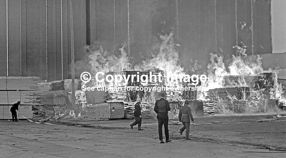 Firemen tackle a major blaze at a timber importer's yard at Belfast docks, N Ireland, UK, on 27th June 1974. The arson attack,  by the Provisional IRA, utilised incendiary devices. 197406270367c<br /> <br /> Copyright Image from Victor Patterson, Belfast, UK<br /> <br /> t: +44 28 9066 1296 (from Rep of Ireland 048 9066 1296)<br /> m: +44 7802 353836<br /> e: victorpattersonbelfast@gmail.com<br /> <br /> www.images4media.com<br /> <br /> Please see my full Terms and Conditions of Use at https://www.images4media.com/p/terms-conditions - it is IMPORTANT that you familiarise yourself with them.<br /> <br /> Images used online incur an additional cost. This cost should be agreed in writing in advance. Online images must be visibly watermarked i.e. © Victor Patterson or that of the named photographer within the body of the image. The original metadata must not be deleted from images used online.<br /> <br /> This image is only available for the use of the download recipient i.e. television station, newspaper, magazine, book publisher, etc, and must not be passed on to a third party. It is also downloaded on condition that each and every usage is notified within 7 days to victorpattersonbelfast@gmail.com.<br /> <br /> The right of Victor Patterson (or the named photographer) to be identified as the author is asserted in accordance with The Copyright Designs And Patents Act (1988). All moral rights are asserted.