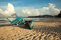 Submerged fishing boat at Ochheuteal Beach or Serendipity Beach, Sihanoukville. Abandoned by its owners, the boat slowly sinks into the sand creating a sort of beach objet unbeknownst to its owners.
