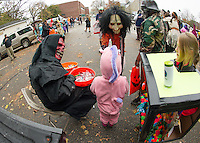 """Jose DeMatos, Jr dressed as the Grime Reaper hands out candy to Holy Trinity """"trick or trunkers"""" Thursday afternoon.  (Karen Bobotas/for the Laconia Daily Sun)"""