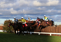 Touch Kick ridden by Harry Cobden (right) on his way to winning the MS Amlin Insurance Novices' Limited Handicap Steeple Chase during day one of the Betfair Tingle Creek Christmas Festival at Sandown Park Racecourse.