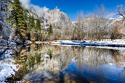 Merced River reflecting the peaks of Yosemite Falls during the lazy river flows of winter.   A touch of winter snow is always a nice accent on the valley.