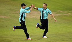 Tom Curran of Surrey celebrates with Jason Roy of Surrey taking the wicket of Michael Klinger of Gloucestershire - Mandatory by-line: Robbie Stephenson/JMP - 06/07/2016 - CRICKET - Brightside Ground - Bristol, United Kingdom - Gloucestershire v Surrey - NatWest T20 Blast
