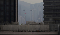 October 1, 2018 - Hong Kong, CHINA - PLA Airforce helicopters that hangs national flag of CHINA and official flag of HKSAR fly over Victoria Harbour exactly 8:00 am in the morning from West to Eastwards as part of China national day celebration. Oct-1,2018 Hong Kong.ZUMA/Liau Chung-ren (Credit Image: © Liau Chung-ren/ZUMA Wire)