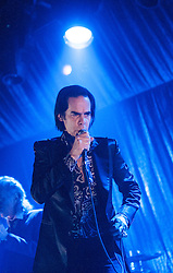 Frontman Nick Cave, of Nick Cave and the Bad Seeds, under a spotlight on stage tonight at The Barrowlands, Glasgow, Scotland.<br /> ©Michael Schofield.