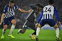 Football - 2019 / 2020 Premier League - Brighton & Hove Albion vs. Leicester City<br /> <br /> Leicester City's Demarai Gray goes down under pressure for a penalty, converted at the 2nd attempt by Jamie Vardy, at The Amex.<br /> <br /> COLORSPORT/ASHLEY WESTERN