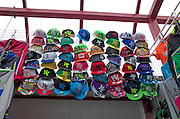 Display of NY city flat brimmed hats for sale at a Polish outdoor street market. Tomaszow Mazowiecki Central Poland