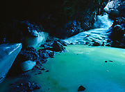 Algae imparting a green color to the Ice flow within Bandera Ice Cave, a lava tube near Bandera Crater and within El Malpais National Monument, New Mexico.