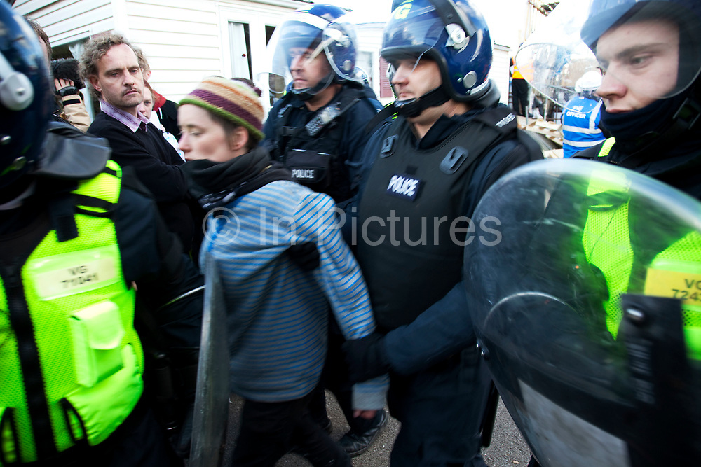 Protester Hannah Pierce arrested by police after being taken from the barricade. Protesters who barricaded themselves above the entrance to the Dale Farm travellers' site have been removed by police as bailiffs prepare to move in. Essex Police cleared the scaffolding structure so it could be dismantled and machinery driven in by bailiffs to evict the travellers. On Wednesday night Essex Police said that over the course of the day 23 people had been arrested. Clearance of Dale Farm prior to eviction. Riot police and bailiffs were present on 19th October 2011, as a scaffolding gantry was cleared of protesters so the site could be cleared. Dale Farm is part of a Romany Gypsy and Irish Traveller site on Oak Lane in Crays Hill, Essex, United Kingdom. Dale Farm housed over 1,000 people, the largest Traveller concentration in the UK. The whole of the site is owned by residents and is located within the Green Belt. It is in two parts: in one, residents constructed buildings with planning permission to do so; in the other, residents were refused planning permission due to the green belt policy, and built on the site anyway.