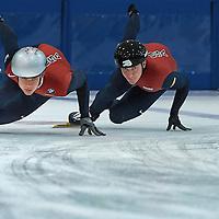 Robert Morris University short track speed skaters Cole Krueger (left) and Robert Lawrence on the ice at Robert Morris University Island Sports Center in Pittsburgh on April 19, 2011. © 2011 Shelley Lipton.