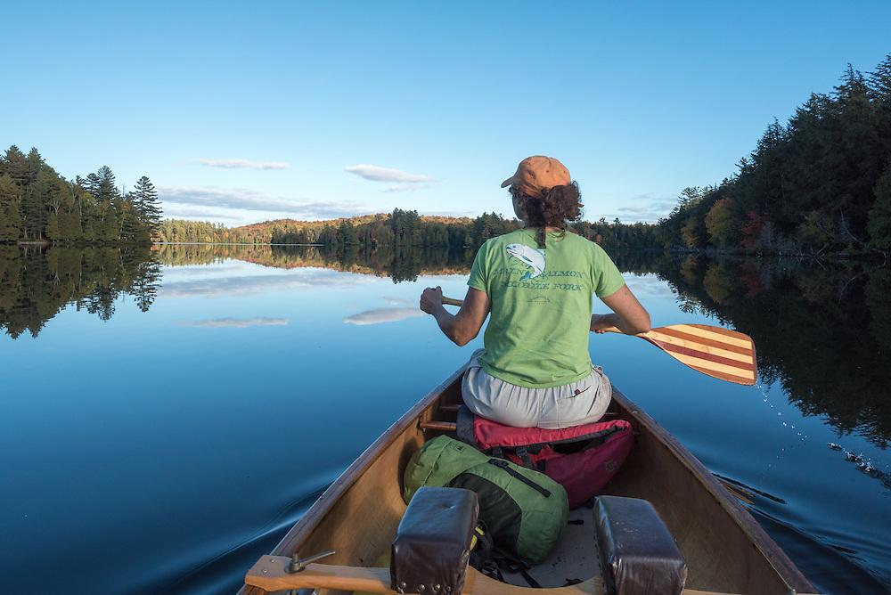 Canoeing in the St. Regis Canoe Area of Adirondack State Park, New York.