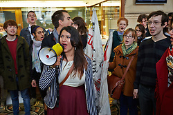© Licensed to London News Pictures.  31/10/2013. Oxford, UK. Students protest in the atrium of the Examination Schools building of Oxford University in support of lecturers and support staff who staged a one day strike over a 1% pay rise offer today.  Photo credit: Cliff Hide/LNP