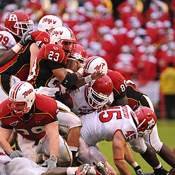 Sep 26, 2009; College Park, MD, USA; Maryland running back Da'Rel Scott (23) runs into a pile of players during Rutgers' 34-13 victory over Maryland in NCAA college football at Byrd Stadium.