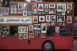 © Licensed to London News Pictures. 11/10/2017. London, UK. A double decker bus in Parliament Square is decorated with photographs of missing family members of six women in the Syrian war. Families for Freedom campaign for the rights of the missing in Syria say that 200,000 are estimated to be in prison in Syria  Photo credit: Peter Macdiarmid/LNP