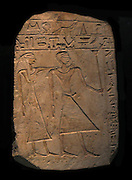 Limestone stele inscribe with an offering formula.  This stele shows a man and his wife.  Traces of red and yellow paint remain.  Said to be from Girgeh.  1st intermediate period, circa 2100 BC