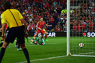 Gareth Bale of Wales shoots and scores his teams 1st goal past Belgium goalkeeper Thibaut Courtois . Wales v Belgium, UEFA Euro 2016 qualifying match at the Cardiff city Stadium in Cardiff, South Wales on Friday 12th June 2015. pic by Andrew Orchard, Andrew Orchard sports photography.