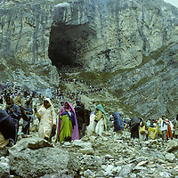 A crowd of Hindu Shiva worshippers swarm below Amarnath Cave during a five-day pilgrimage through the Himalaya in Kashmir, India.