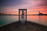 """""""Boy with frog"""" is a sculpture in white steel of the Los Angeles based artist Charles Ray. It's prominently situated on the very tip of the Punta della Dogana, exactly where the Grand Canal, the Giudecca Canal and the San Marco basin converge, and it was placed here at the beginning of June 2009 for the opening of the new exhibition center at the Dogana. Taken in twilight about 30 minutes before sunrise, this is a very long exposure: 160"""" @f11"""
