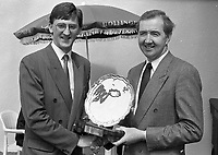Mr David Sheedy, Sales and Marketing Manager of Woodford Bourne, presenting the Trainer of the Year Award to Dermot Weld at Punchestown, 24/04/1990 (Part of the Independent Newspapers Ireland/NLI Collection).