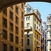 A row of business and apartment buildings on the edge of the Gothic Quarter in Barcelona, Spain.<br /> <br /> LICENSING: This is a Royalty Free (RF) image that can only be licensed through SpacesImages. Click on the link below:<br /> <br /> http://tinyurl.com/cq7j5ok