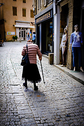 An old lady walks in the Rue Cros Mayrevielle in the medieval  Cité de Carcassonne, France<br /> <br /> (c) Andrew Wilson | Edinburgh Elite media