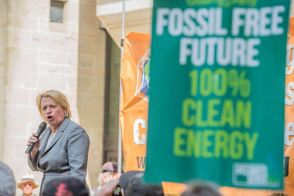 Natalie Bennett - A perfect summers day for the Campaign against Climate Change's backwards march – on the governments first anniversary in power the protestestors  wanted to highlight their belief that clean energy technology has been sidelined in favour of a 'dash for gas, insulation cut and fracking, roads and runways pushed through despite strong local opposition'. They walked backwards from Traflagar Square, down Whitehall, ending at the DoH.