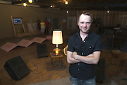 """Tyler Morrison poses in the upstairs rehearsal area as Wise """"Doc"""" Smith entertains guests in the 13,000-sq.-ft. building that is the future home of Liquid Sound Studios, Thursday, July 26, 2012, on Corydon Pike in New Albany, Ind. (Photo by Brian Bohannon)"""