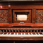 A harmonium built by the Aeolian Organ and Music Co in New York around 1890 on display in the Musical Instrument Museum in Brussels. The Musee des Instruments de Musique (Musical Instrument Museum) in Brussels contains exhibits containing more than 2000 musical instruments. Displays include historical, exotic, and traditional cultural instruments from around the world. Visitors to the museum are given handheld audio guides that play musical demonstrations of many of the instruments. The museum is housed in the distinctive Old England Building.
