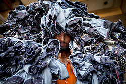 June 21, 2017 - Dhaka, Dhaka, Bangladesh - June 21, 2017 Dhaka, Bangladesh - Garments labour carry denim jeans transport for local market in Dhaka. (Credit Image: © K M Asad via ZUMA Wire)