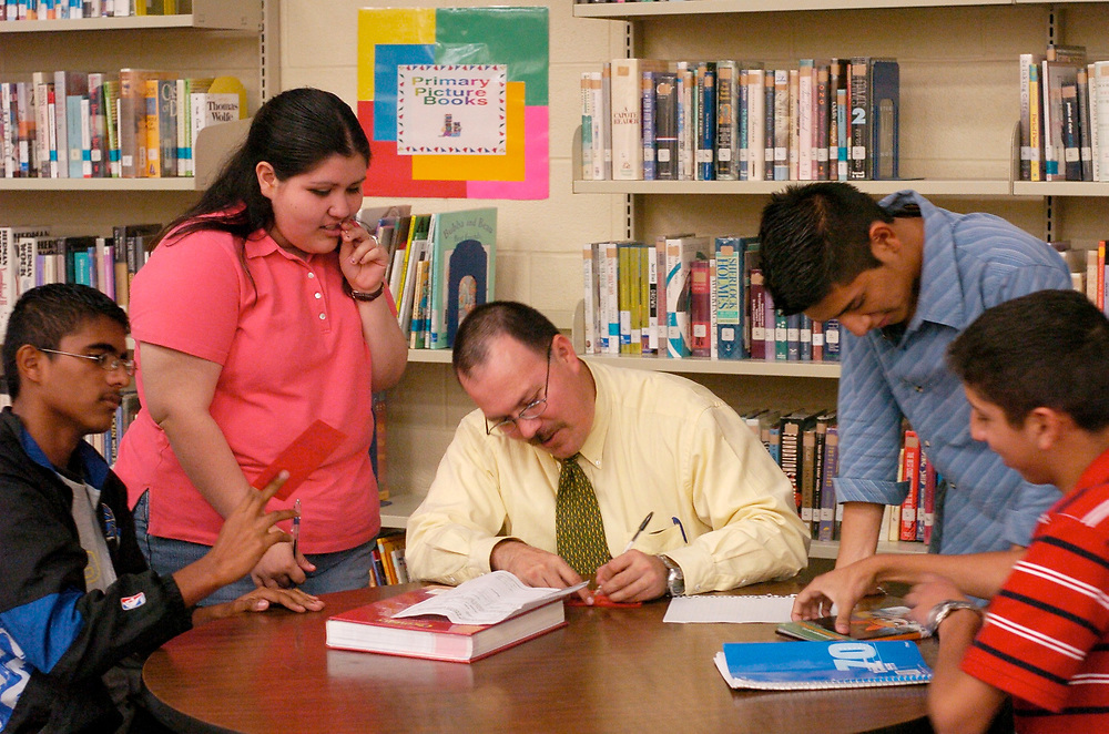 Brownsville, TX January, 2006:  After-school tutoring by teachers for students who want to perform better on standardized tests, taking place in the school library.