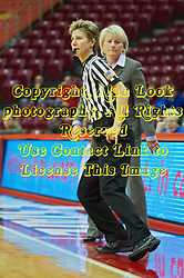 03 January 2014:  Referee Laura Morris almost bumps into Head Coach Barb Smith during an NCAA women's basketball game between the Drake Bulldogs and the Illinois Sate Redbirds at Redbird Arena in Normal IL