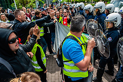 May 26, 2019 - Brussels, North Brabant, Belgium - May 26th, Brussels. Under the slogan 'Toute l'Europe à Bruxelles', hundreds of yellow vests from some parts of Europe, gathered at the Brussels North station to keep their protests during the European election day.The situation escalated around the North station, where the demonstration wasn't allow to walk by the police. Hundreds of riot police showed up and stopped the demonstration. The police used water cannons and tear gas to disperse protesters. A group of hundreds yellow vests managed to evade the riot police and run to the center of the city, where they were arrest when they tried to hide inside of a watch store. (Credit Image: © Romy Arroyo Fernandez/NurPhoto via ZUMA Press)