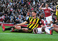 FOOTBALL - 2018 / 2019 Premier League - Arsenal vs. Watford<br /> <br /> Despair for Craig Cathcart of Watford under pressure from Lacazette, puts the ball into his own net for Arsenal's first goal, at the Emirates<br /> <br /> COLORSPORT/ANDREW COWIE