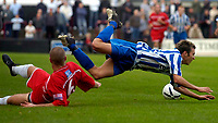 Photo: Alan Crowhurst.<br />Welling United v Clevedon Town. The FA Cup Qualifying. 28/10/2006. Jack Pitcher (R) of Clevedon is fouled.