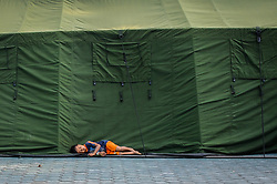 October 4, 2018 - Palu, Indonesia - A boy falls asleep beside the tent at theKorem Refugee settlement in Palu..A deadly earthquake measuring 7.7 magnitude and the tsunami wave caused by it has destroyed the city of Palu and much of the area in Central Sulawesi. According to the officials, death toll from devastating quake and tsunami rises to 1,347, around 800 people in hospitals are seriously injured and some 62,000 people have been displaced in 24 camps around the region. (Credit Image: © Hariandi Hafid/SOPA Images via ZUMA Wire)
