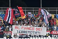 Tifosi del Genoa con striscione A fianco dei Terremotati. Genoa fans with a banner for eartquake victims <br /> Pescara 28-08-2016  Stadio Adriatico <br /> Campionato Serie A, Crotone - Genoa <br /> Foto Andrea Staccioli / Insidefoto