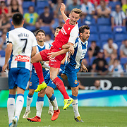 BARCELONA, SPAIN - August 18:  Luuk De Jong #19 of Sevilla wins a challenge for the ball with Victor Sanchez #4 of Espanyol during the Espanyol V  Sevilla FC, La Liga regular season match at RCDE Stadium on August 18th 2019 in Barcelona, Spain. (Photo by Tim Clayton/Corbis via Getty Images)